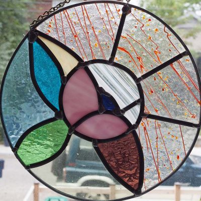 Art 1 Holding Stained Glass