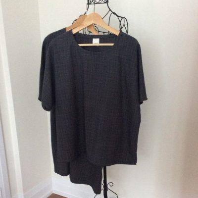 Two grey plaid woolly tunics